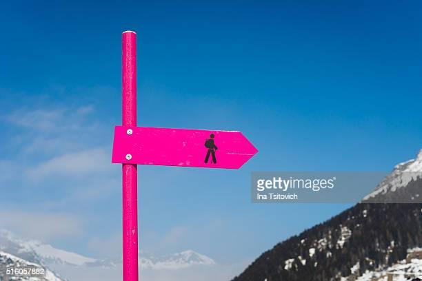 Pink winter trail sign, Switzerland