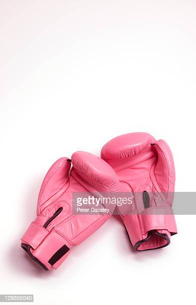 pink woman's boxing gloves - boxing gloves stock photos and pictures