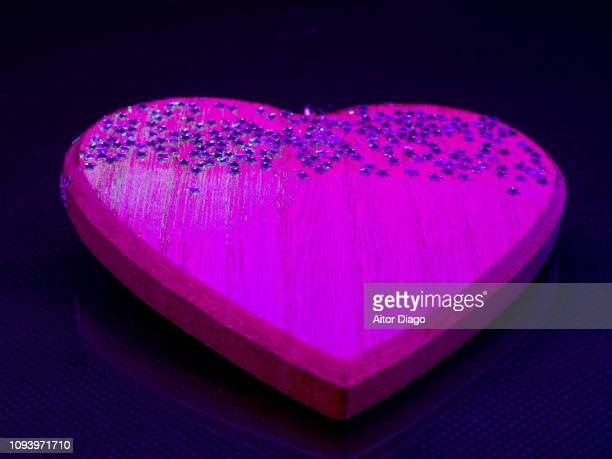 Pink wooden heart with small stars.