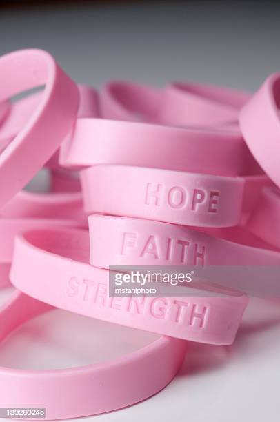 Pink wrist bands with different inspirations on them