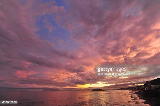 Pink-colored clouds on the sunset beach