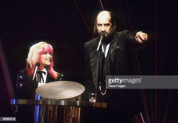 Pink-haired Samantha Fox joins forces with Mick Fleetwood to present the infamous 1989 Brit Awards.