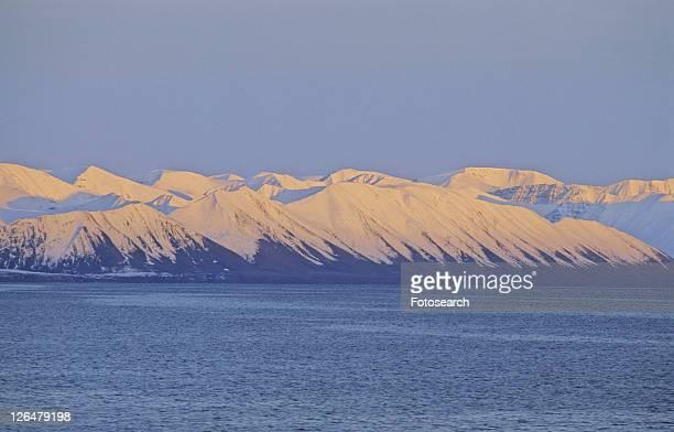 Pinkish evening sun on the mountain slopes of Northern Spitsbergen.