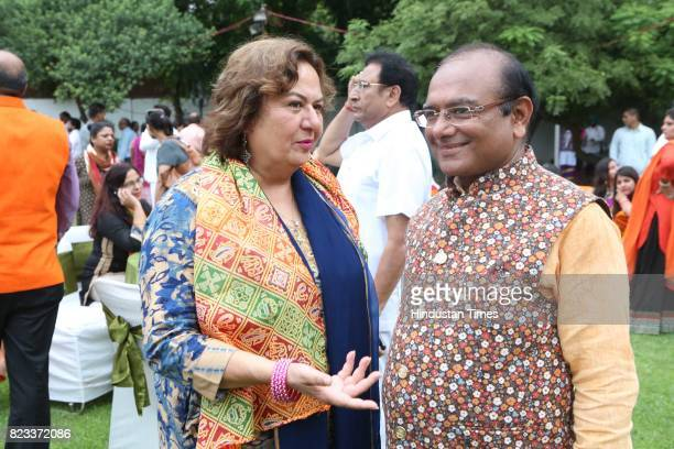 Pinky Anand and Mukesh Gupta during the Teej festival celebrations organised at the residence of Smriti Irani on July 25 2017 in New Delhi India The...