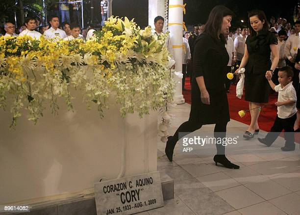 Pinky Aquino the second daughter of former Philippine President Corazon 'Cory' Aquino leaves her mother's tomb as youngest daughter Kris and her son...