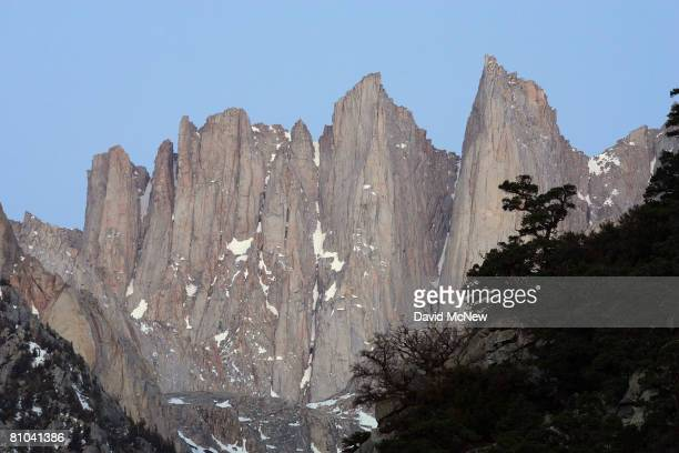 Pinnacles rise from the crest just south of Mount Whitney the tallest peak in the continental US at 14494 feet in the Sierra Nevada Mountains which...