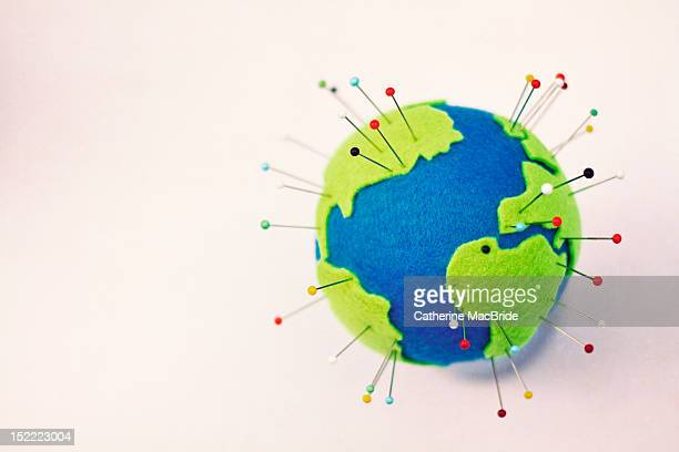 pinning globe - push pin stock pictures, royalty-free photos & images