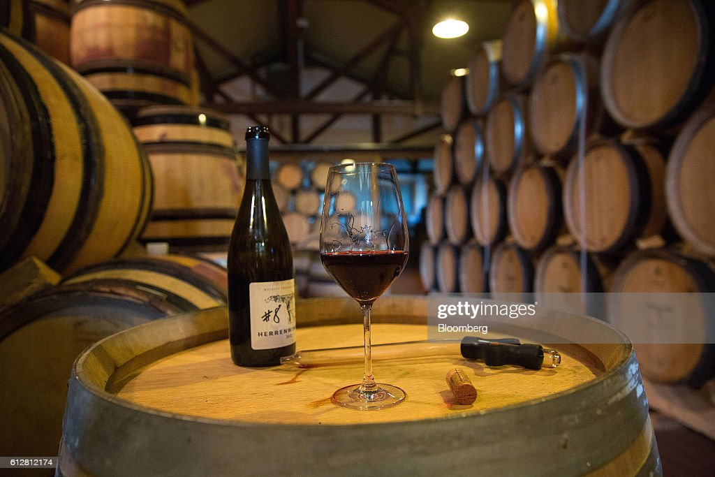 Pinot noir wine, also known as spaetburgunder, sits in a glass during a testing session in a temperature controlled building inside the Weingut Friedrich Becker Estate in Schweigen, Germany, on Tuesday, Oct. 4, 2016. Global warming has been good to German viticulture, with average temperatures up 1.4 degrees centigrade over the past 40 years, creating the perfect climate for notoriously finicky pinot noir vines. Photographer: Krisztian Bocsi/Bloomberg via Getty Images
