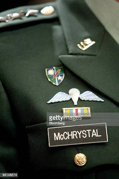 Pins adorn the jacket of Army General Stanley McChrystal commander of US forces in Afghanistan during a House Armed Services Committee hearing in...