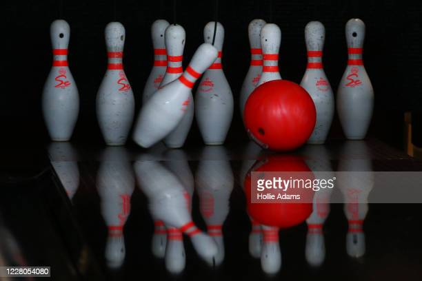 Pins are bowled over at All Star Lanes bowling alley at Westfield in White City on August 15, 2020 in London, England. Theatres, casinos and bowling...