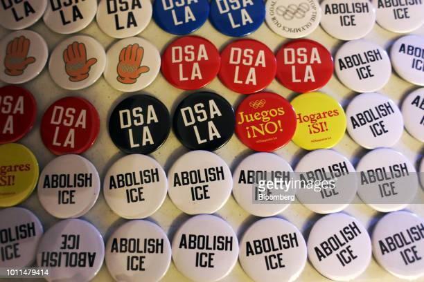 Pins are displayed for sale during an event for Alexandria OcasioCortez Democratic US Representative candidate from New York at the First Unitarian...