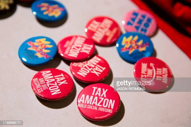 Pins are pictured during a Tax Amazon 2020 Kickoff event and inauguration for Seattle City Councilmember Kshama Sawant in Seattle Washington on...