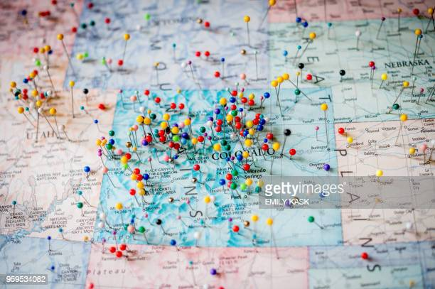 Pins from where visitors have come from on a map is displayed in Shooters Grill in Rifle Colorado on April 24 2018 Lauren Boebert opened Shooters...