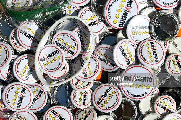 Pins of Italy's populist Five Star Movement are seen during the party's congress in Rimini on September 23, 2017. Italy's populist 5-Star Movement...
