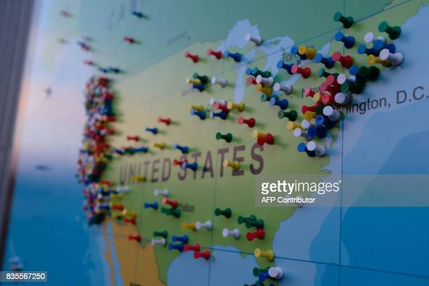 Pins on a map locate the hometowns of travelers visiting Madras Oregon on August 18 the rural central and eastern part of Oregon is hosting dozens of...