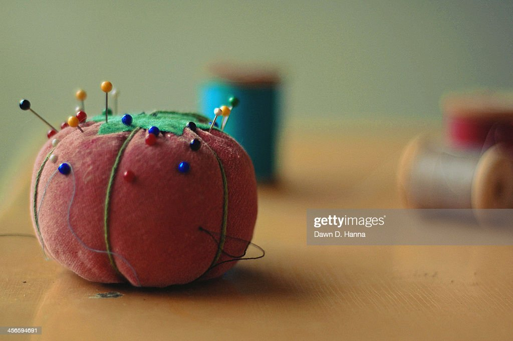 Pins on a Tomato : Stock Photo