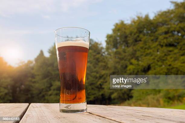 Pint glass of beer on a patio table