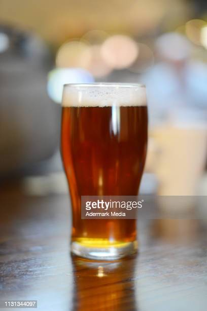 a pint in the pub - ale stock pictures, royalty-free photos & images