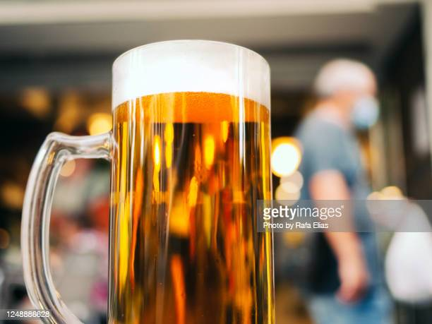 pint of beer, drinking alcohol in times of covid-19 - corona beer stock-fotos und bilder