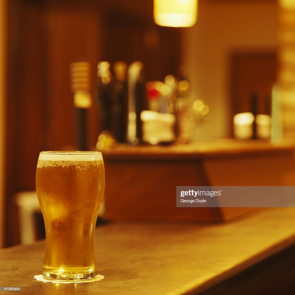 Pint of beer on bar counter : Stock Photo