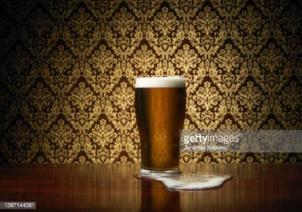 pint of beer on table - pub stock pictures, royalty-free photos & images