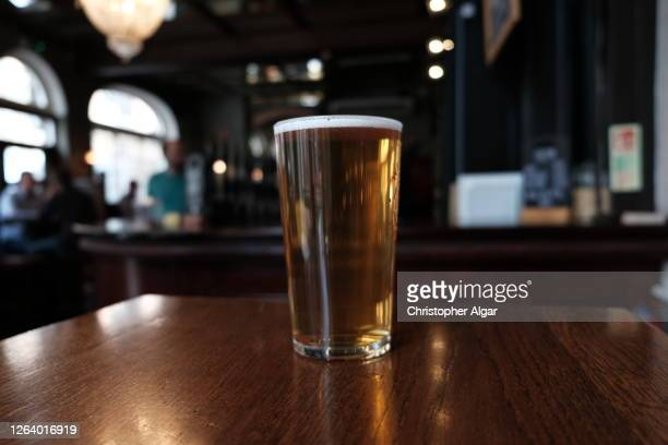 pint of craft beer - table stock pictures, royalty-free photos & images