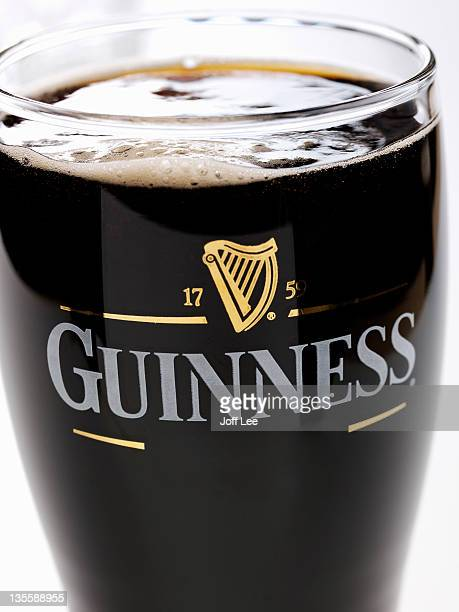 a pint of guinness - guinness stock pictures, royalty-free photos & images