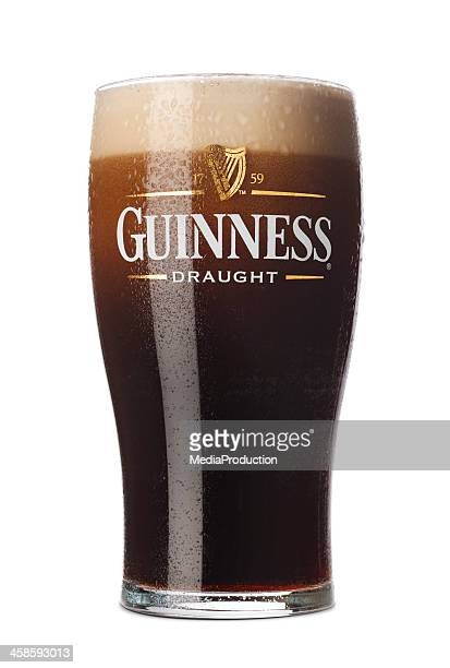 pint of guinness - guinness stock photos and pictures