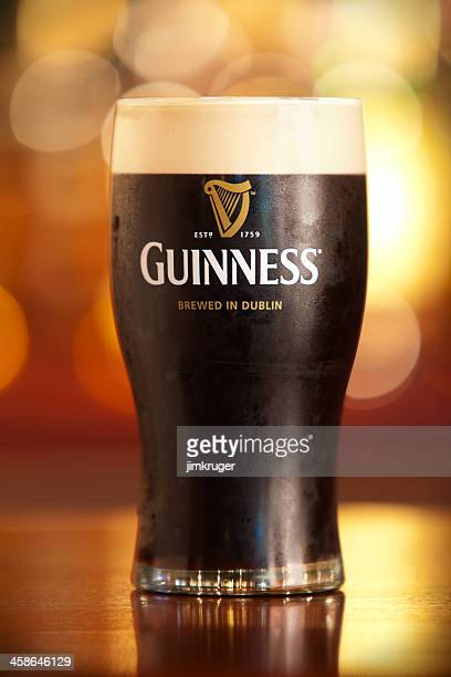 pint of guinness. - guinness stock photos and pictures