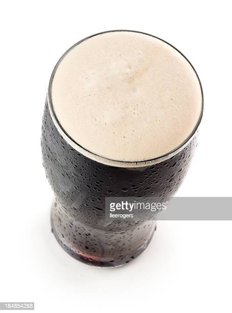 Pint of stout head froth isolated on a white background