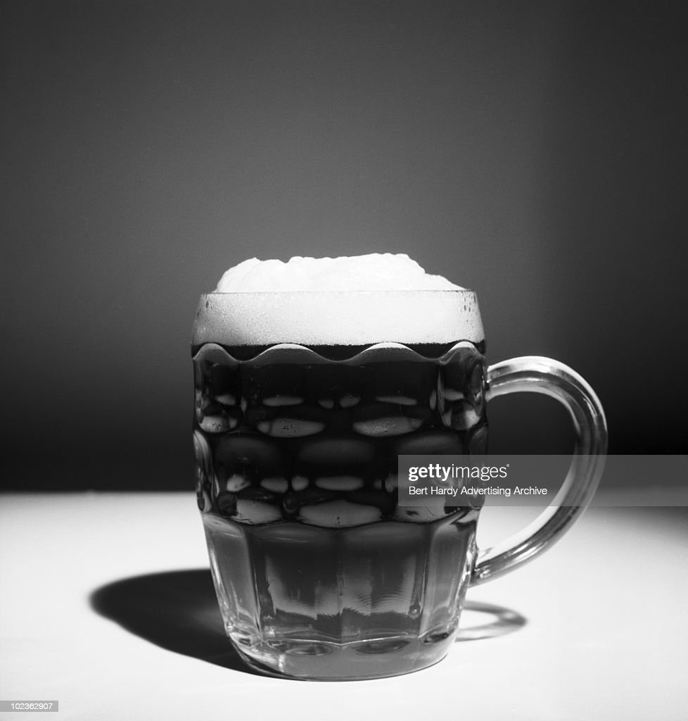 A pint of Tartan bitter with a foamy head, 21st April 1966.