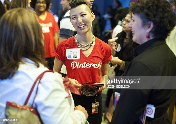 Pinterest employee Enid Hwang speaks with attendees during a Pinterest media event at the company's corporate headquarters office in San Francisco...