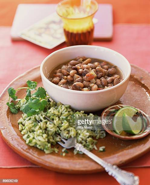pinto beans and cilantro rice - pinto bean stock pictures, royalty-free photos & images