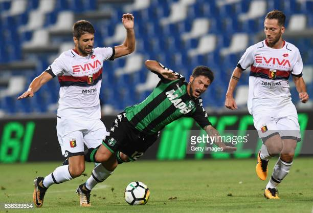 Pinto Veloso Miguel of Genoa CFC competes for the ball whit Stefano Sensi of US Sassuolo during the Serie A match between US Sassuolo and Genoa CFC...
