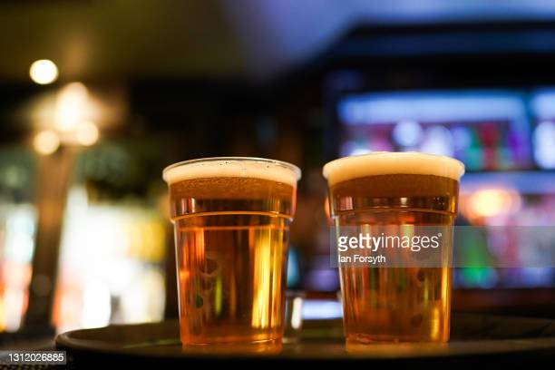 Pints are lined up in the Switch bar in Newcastle as the pub opens following the easing of lockdown measures on April 12, 2021 in Newcastle Upon...