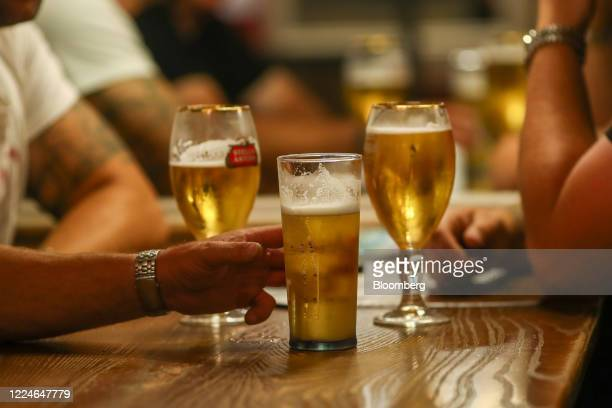 Pints of beer sit on a table at The Moon Under Water pub operated by J D Wetherspoon Plc on Leicester Square in London UK on Saturday July 4 2020...