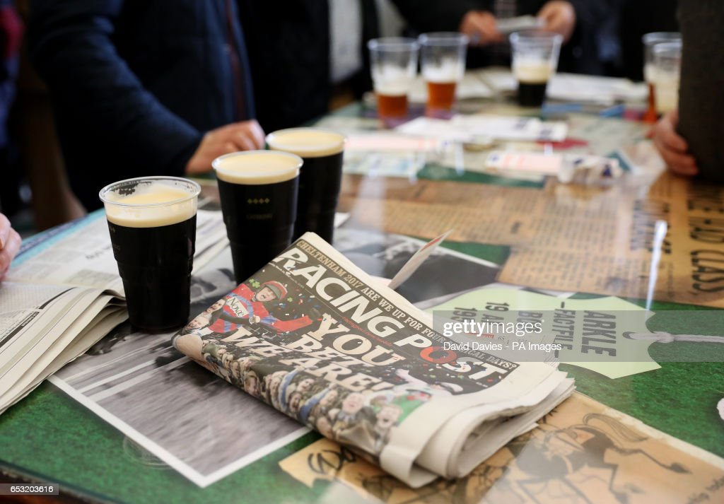 Pints of Guinness and the Racing Post in the Arkle bar during Champion Day of the 2017 Cheltenham Festival at Cheltenham Racecourse.