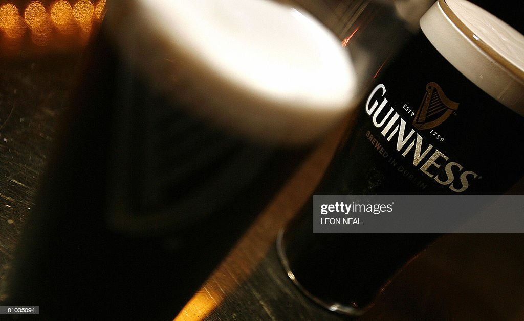 Pints of Guinness beer are pictured in L : News Photo