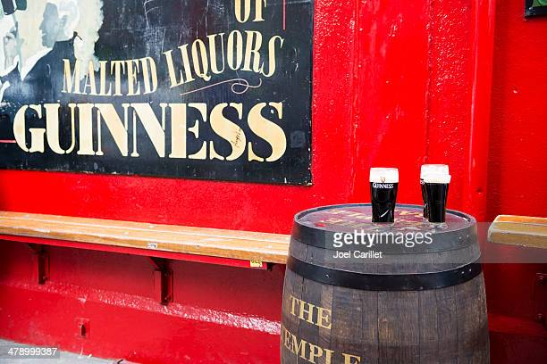 pints of guinnesss at temple bar dublin - guinness stock photos and pictures