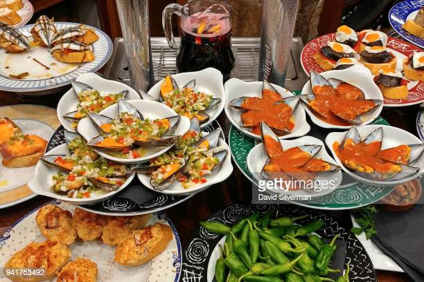 """Pintxos the Basque cousin to Spanish tapas are served in a bar on October 12 2016 in the Old Town in San Sebastian Spain """"Pintxo"""" traditionally..."""