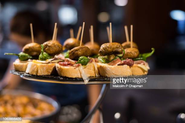 pintxos, typical basque tapas - bilbao stockfoto's en -beelden