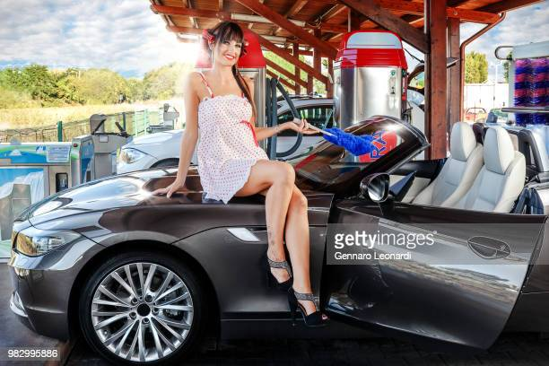 pinup at the car wash - car wash brush stock pictures, royalty-free photos & images