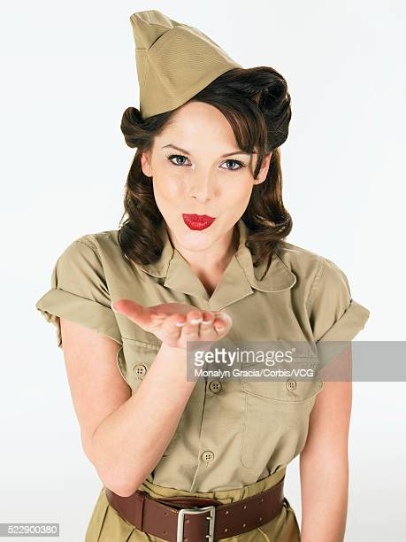 pinup blowing kisses at camera - 40s pin up girls stock photos and pictures