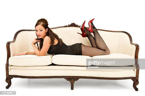 pinup girl on antique sofa - beautiful women in pantyhose stock pictures, royalty-free photos & images