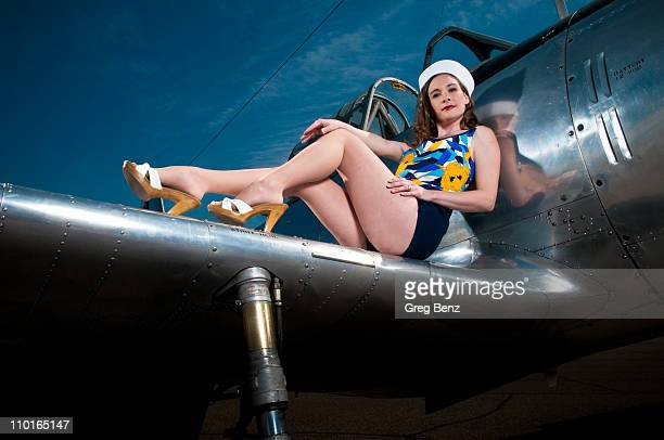 Pinup girl on the wing of a WWII Fighter Plane