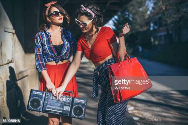 Pin-up girls enjoying beautiful sunny day with boom box