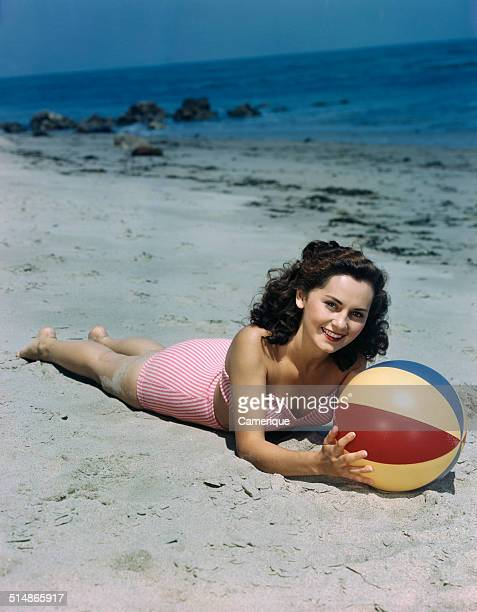 Pinup lying on beach Los Angeles California 1949