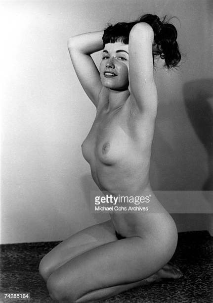 Pinup model Bettie Page poses for a nude portrait in circa 1952