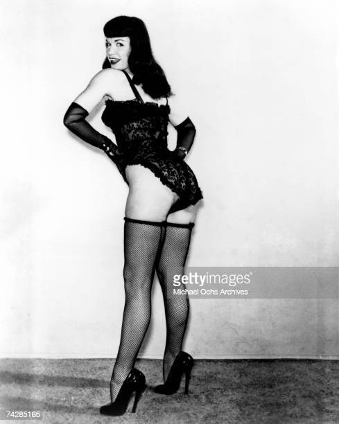 Pinup model Bettie Page poses for a portrait wearing lingerie in circa 1952