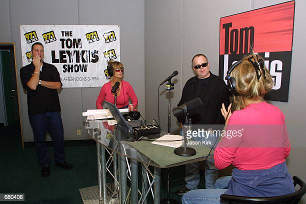 Pinup models Shane and Sia Barbi pose for a photograph with Radio Talk Show Host Tom Leykis at his studio November 8 2001 in Los Angeles CA The twins...